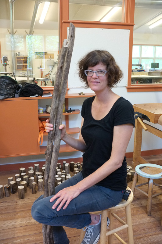 "Meredith Brickell with a few of the sticks she was cutting up and painting for a temporary installation. ""This is my strongest group of alumni."""