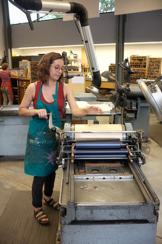 Marianne Dages working in letterpress.