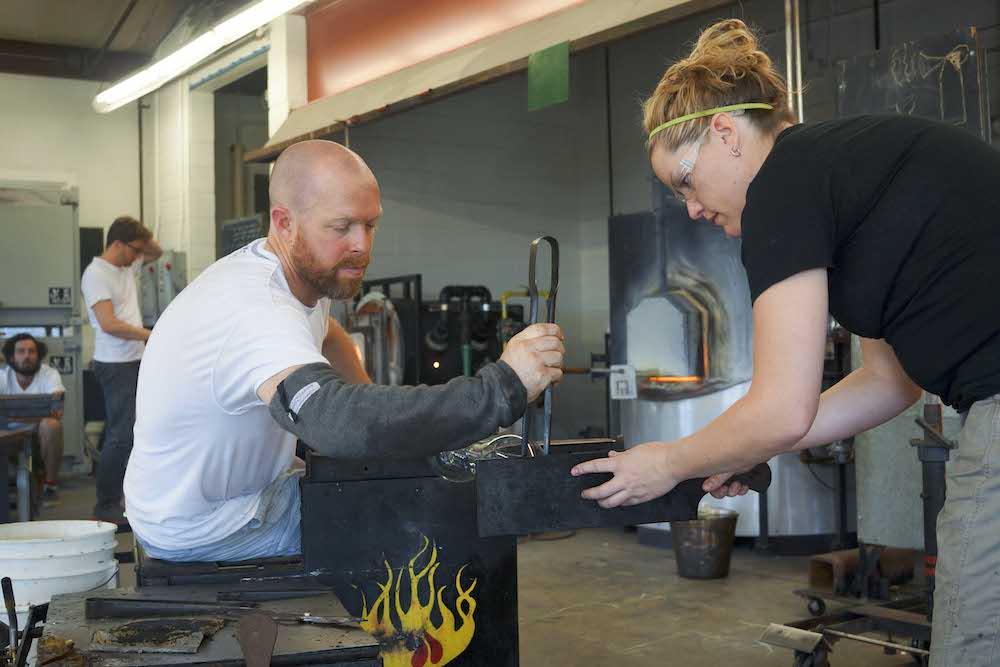 Brian Corr and assistant Suzie Ririe shaping the body.