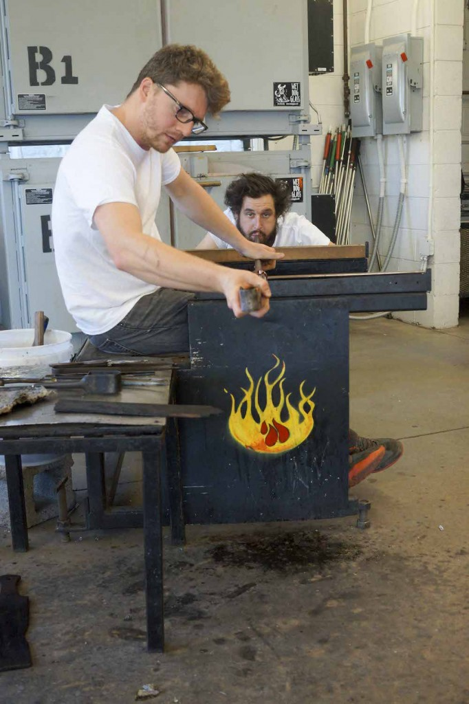 Assistant Nick Fruin and Pierre Bowring making the elongated stem of the vessel.