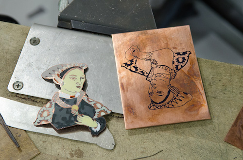 At the bench, a continuing collaboration between Ian and Audrey Bell--wearable enameled figures inspired by author Hilary Mantel's fiction about Cromwell's rise in 16th century England.