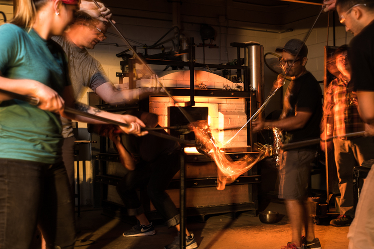 students and instructors working together in Penland's hot glass studio