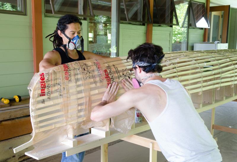 Tom Huang skinning a canoe