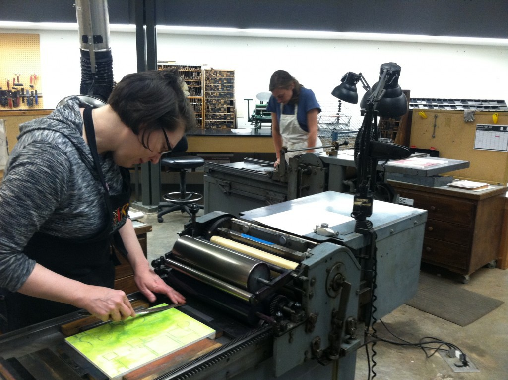 students printing on Penland's letterpress equipment