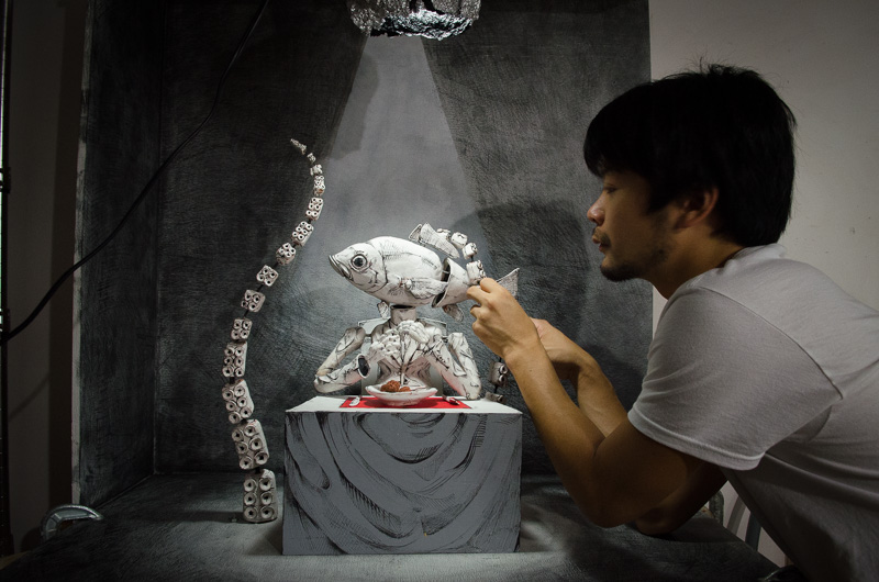 man working on stop-motion animation
