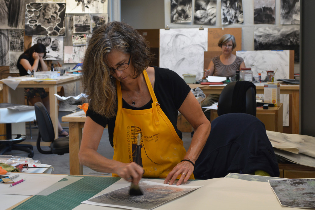 Lisa Blackburn working on top of her photographs