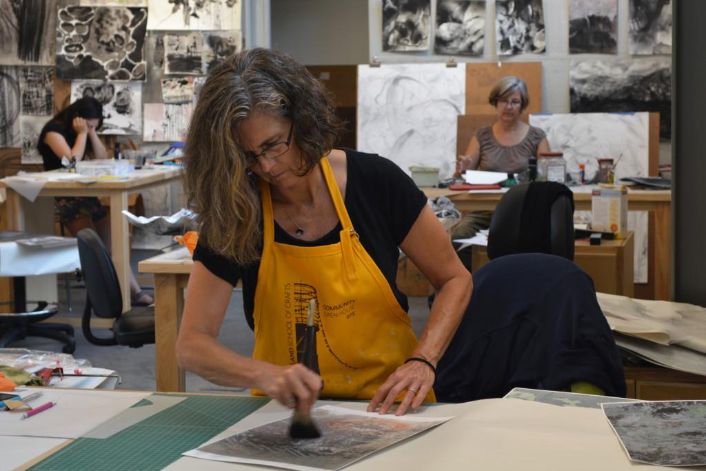 Lisa Blackburn working on top of her photographs