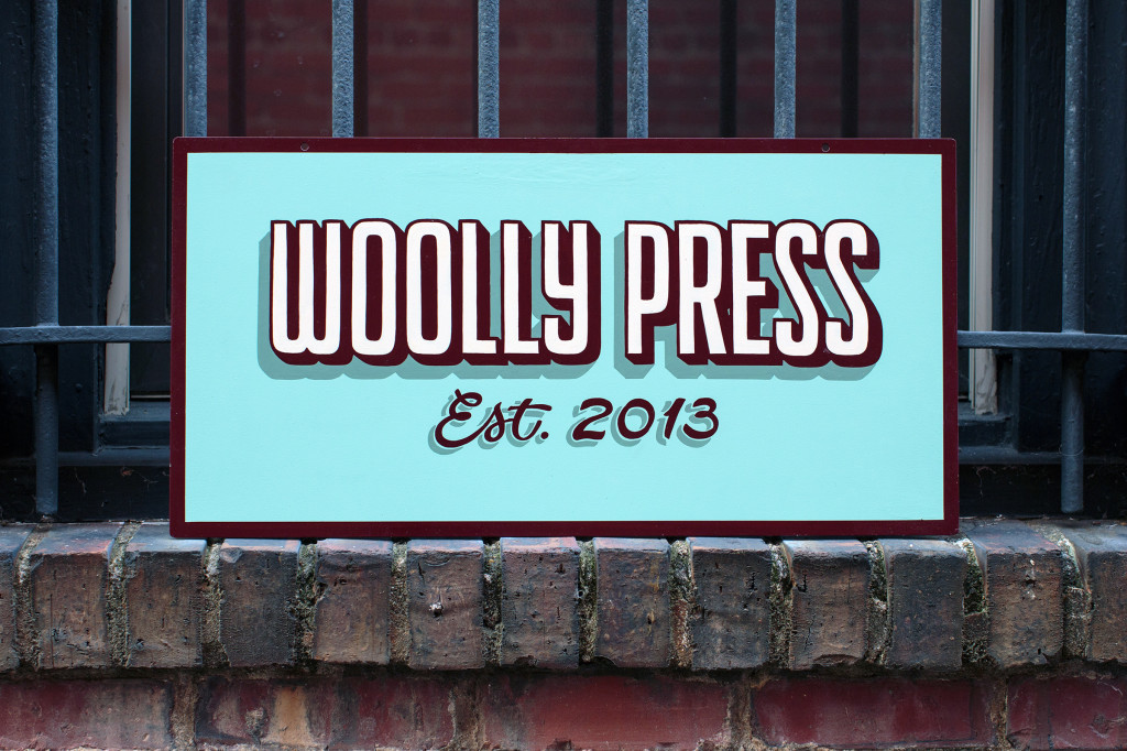 "handpainted ""Woolly Press"" sign"