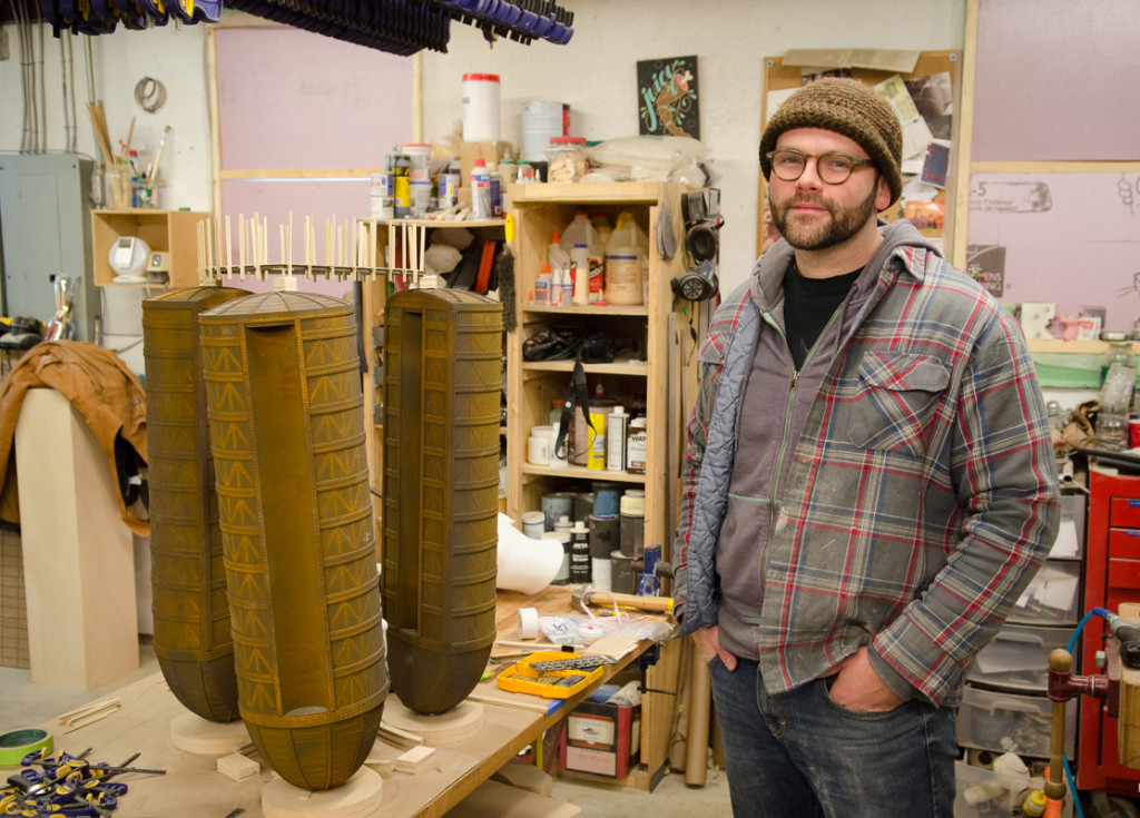 Dustin Farnsworth with some of his sculpture