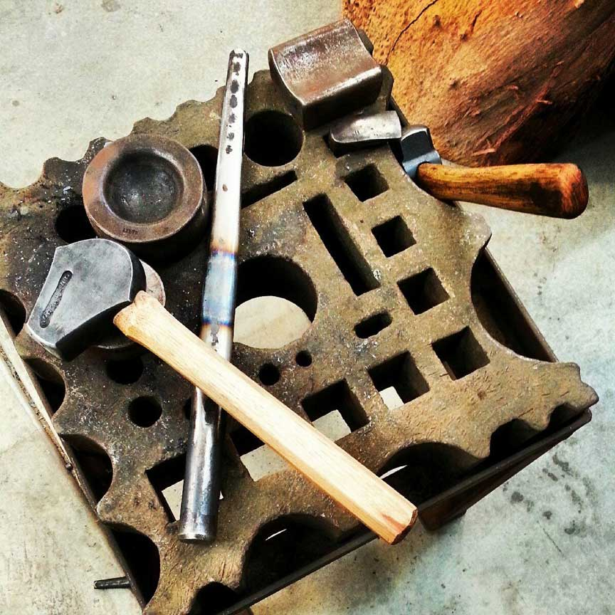 hammer and other blacksmithing tools