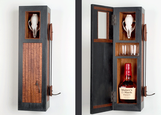 """O'Possum Whiskey, 2005. As Sylvie describes, """"The whiskey cabinets beckon as kinetic skulls agree, you should have another drink."""" Photo by Larry Stanley"""