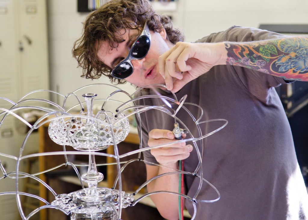 Micah Evans working on a flameworked glass piece
