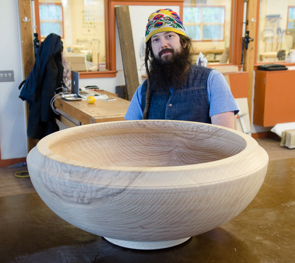 man and a large wooden bowl