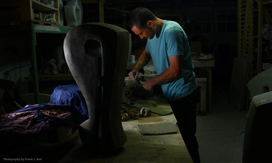 Eric Knoche working on a clay sculpture