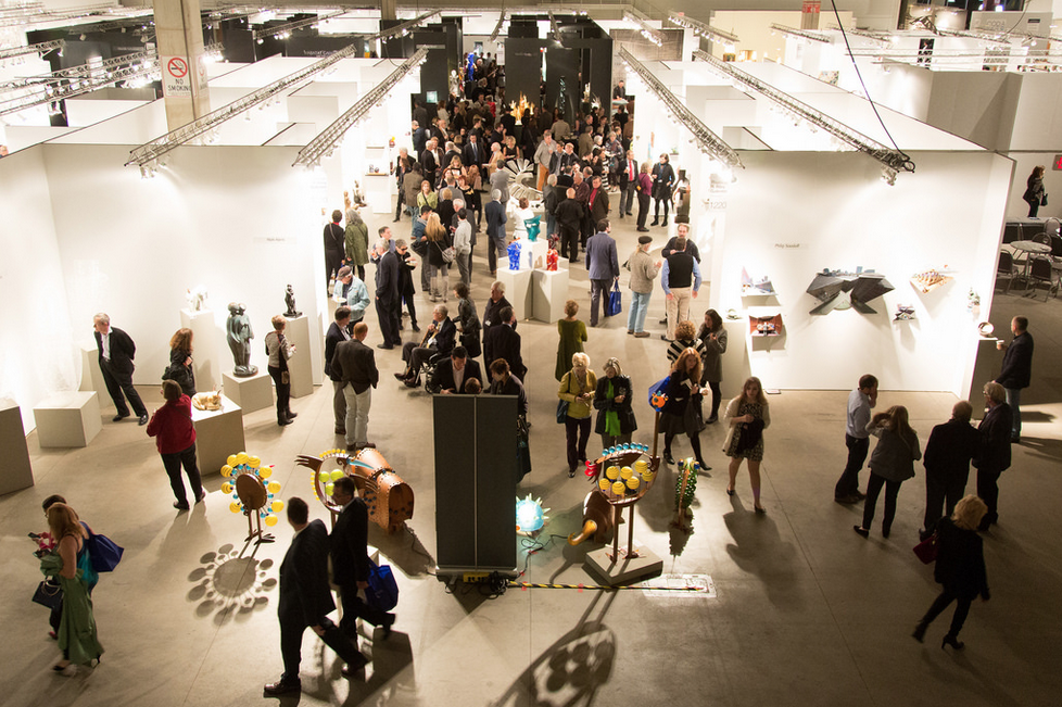 visitors looking at art on display