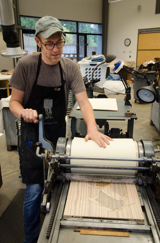 Instructor Phil Sanders using a Vandercook press.