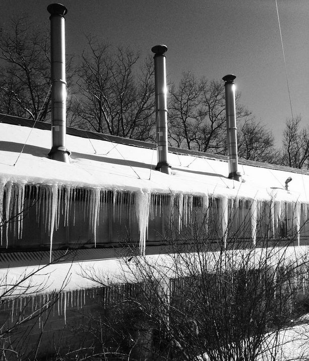 And some giant icicles setting up shop on the iron studio. Photo by christinaboydesign