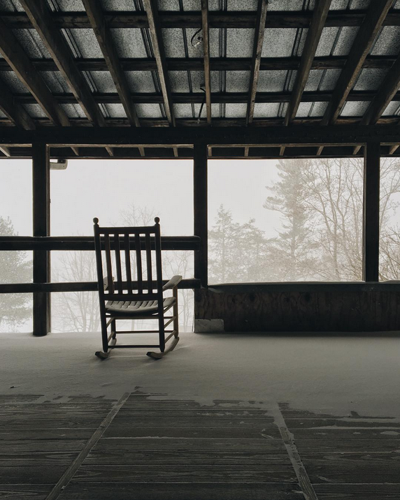 Snowy porch sit. Photo by nickeshep