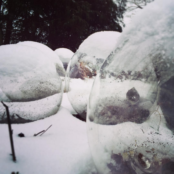Hollow spheres with snow hats outside the glass studio. Photo by ohcriminy