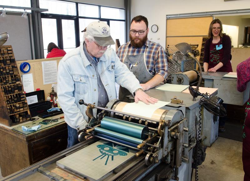 In the letterpress studio, visitors printed masks on the Vandercook press.