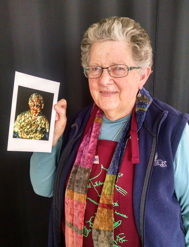 Edwina poses with her gold-sequined portrait.