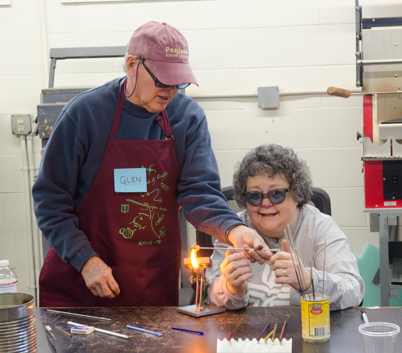 In the flameworking studio, visitors made glass beads.