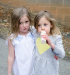 young girls blowing on a whistle