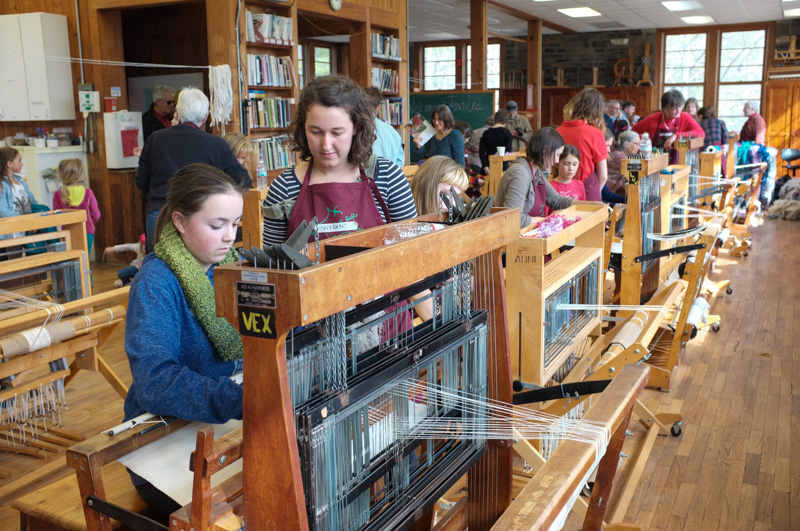 Visitors to textiles learned to weave at the looms.