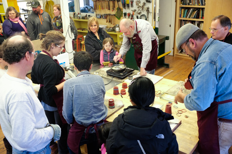 In the metals studio, visitors learned pewter casting.