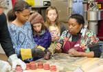 girls unmolding a pewter cast
