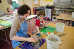 mother and daughter making paste paper