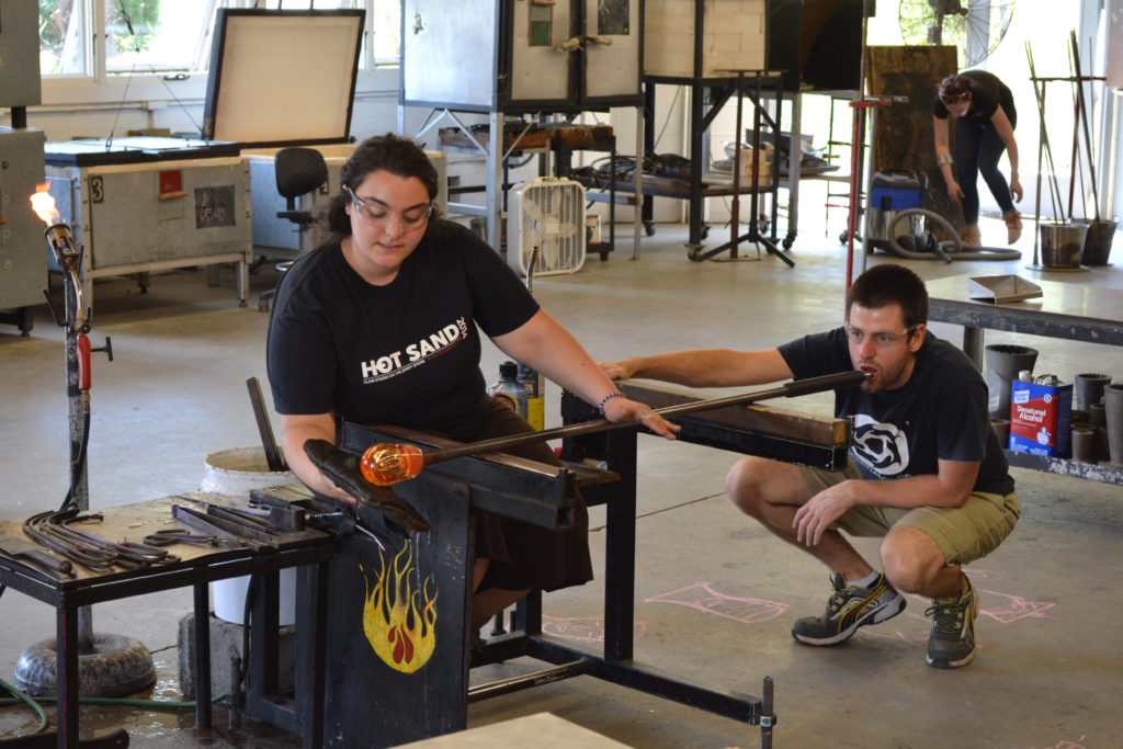 Some glass blowing teamwork.