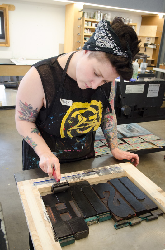 Inking wood type to add to a print