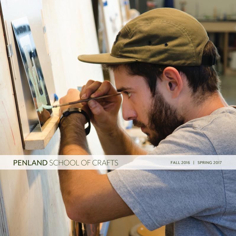catalog cover showing a man painting a sign