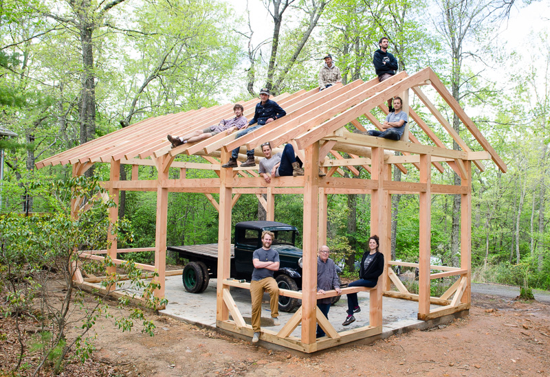 The timber framing class posing on the frame they raised
