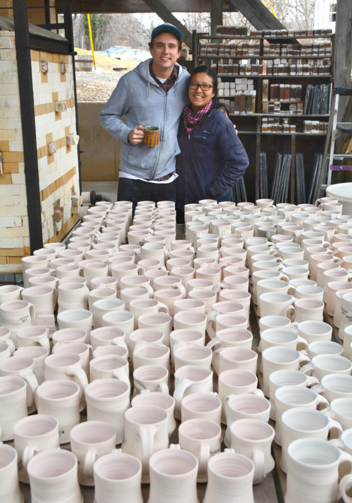 Potters pose with over 200 mugs ready to be fired
