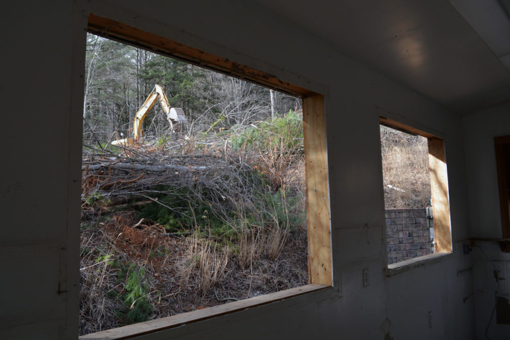 A view through the papermaking studio of ground being cleared to make way for the new building.