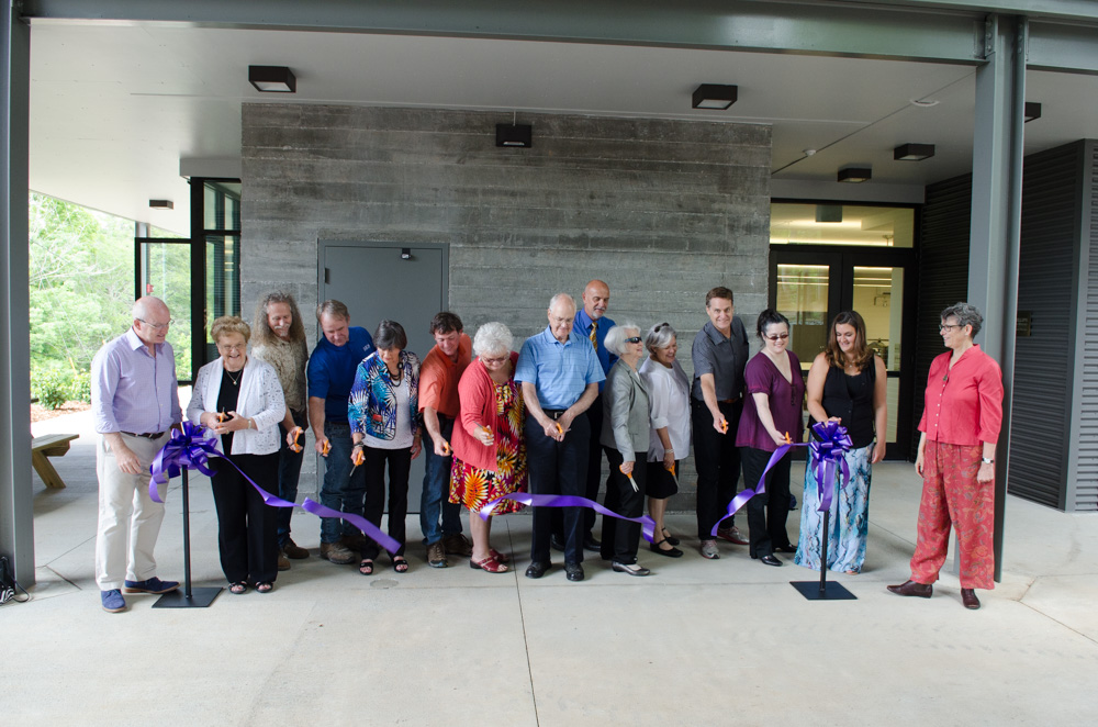 cutting the ribbon for the opening of new studio buildings