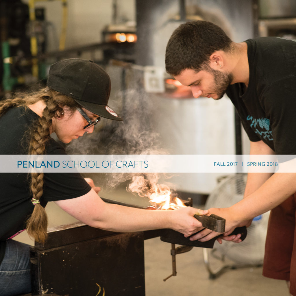 Fall 2017/Spring 2018 Penland catalog cover showing two students blowing glass