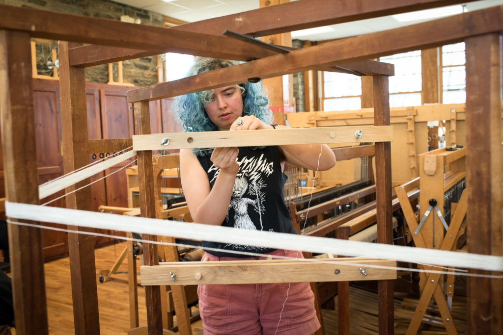 Allie Dudley using a warping mill at Penland
