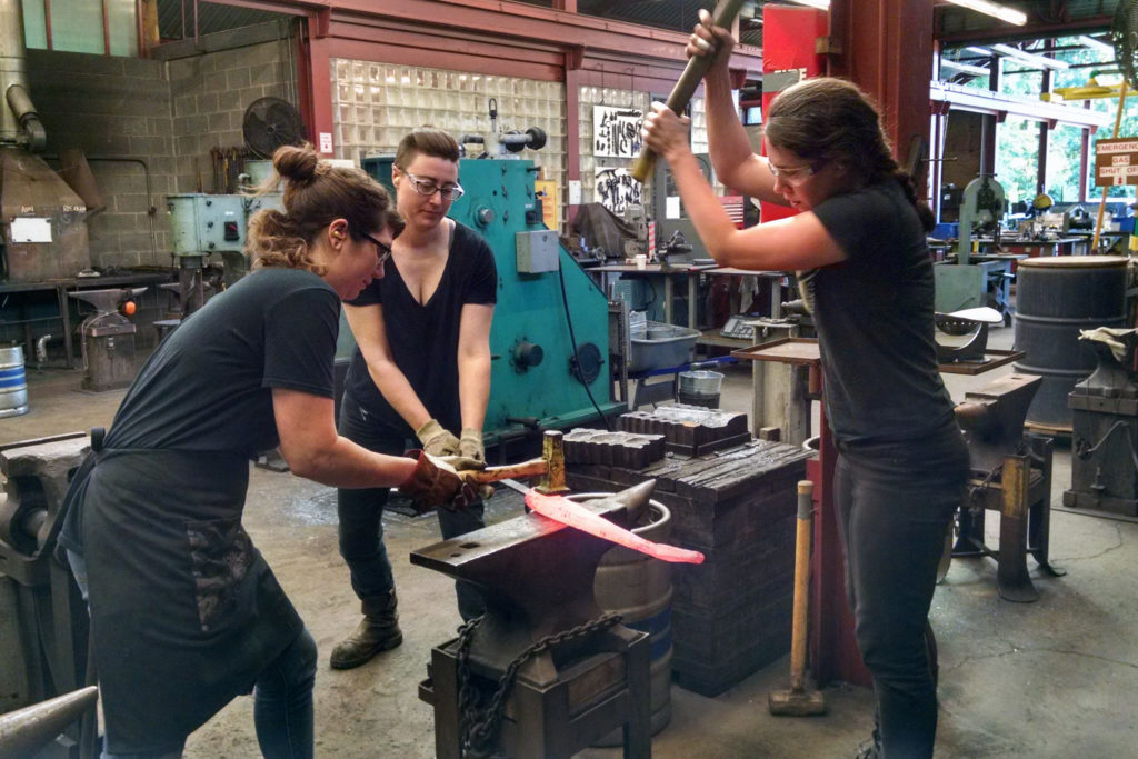 three women working at the anvil