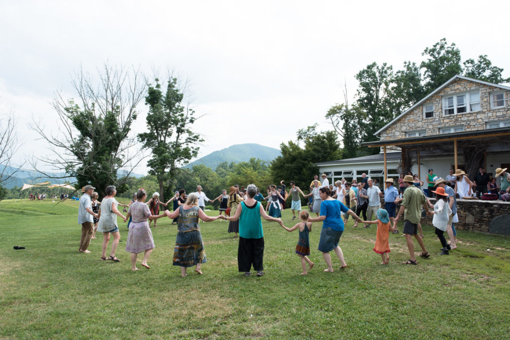 In front of The Pines, some folks did the dance that Paulus used to end his workshops.