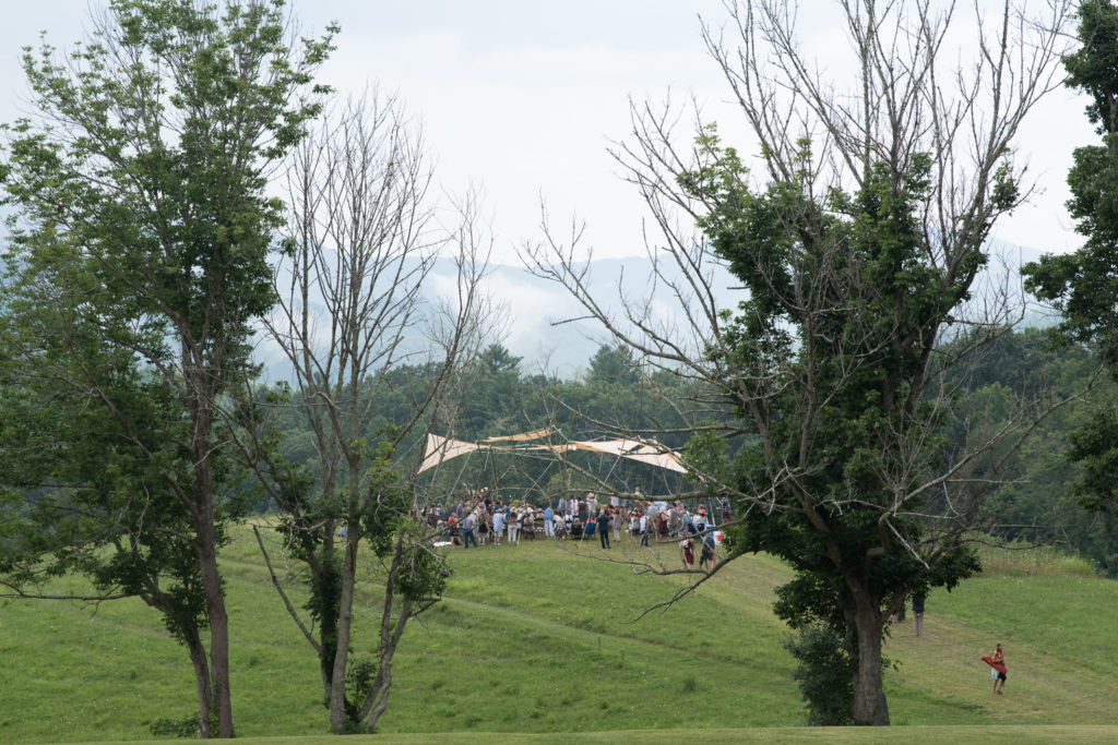 People gathering on the knoll.