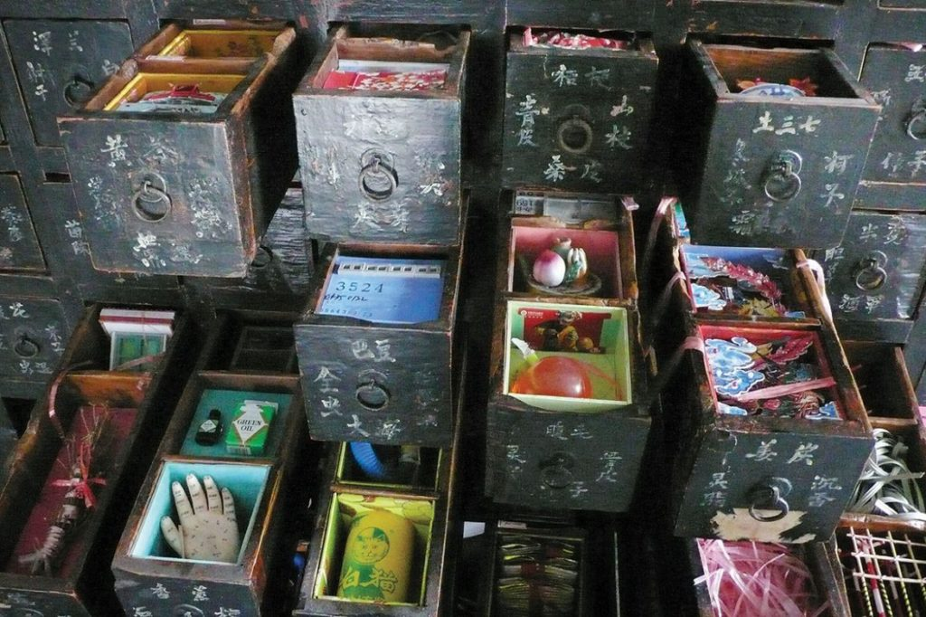 close-up of drawers filled with mementos