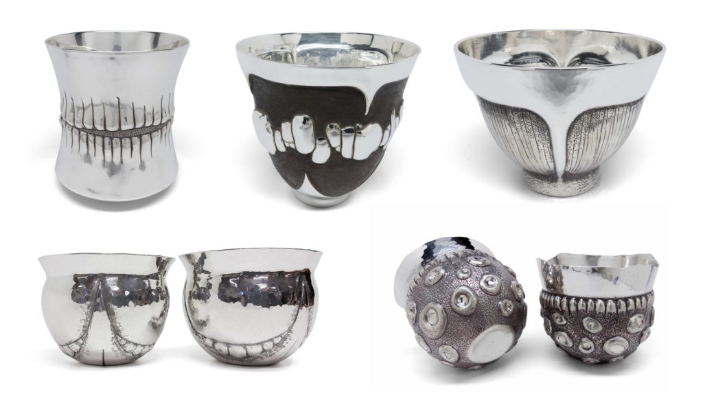 raised cups by Adam Whitney