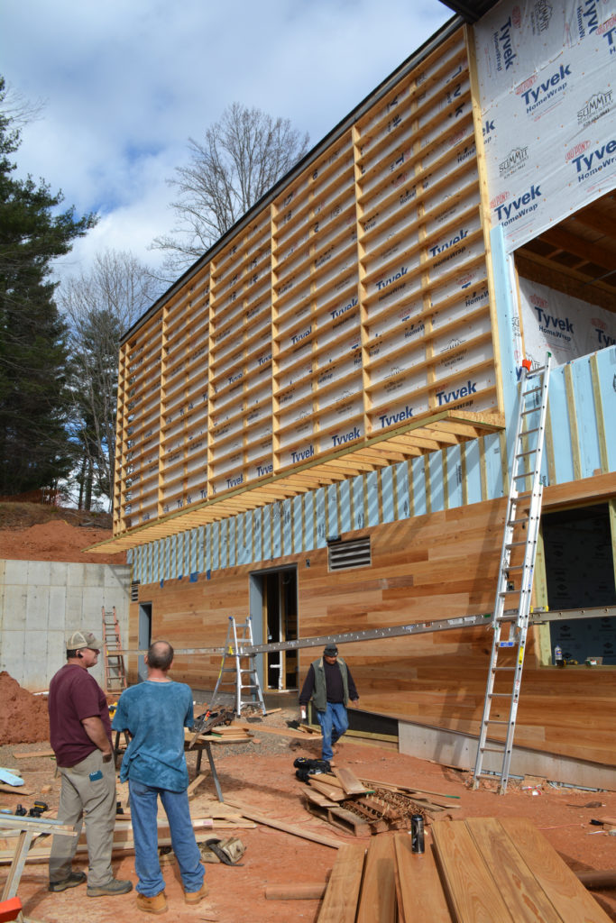 This beautiful wooden siding will clad part of the building's exterior.