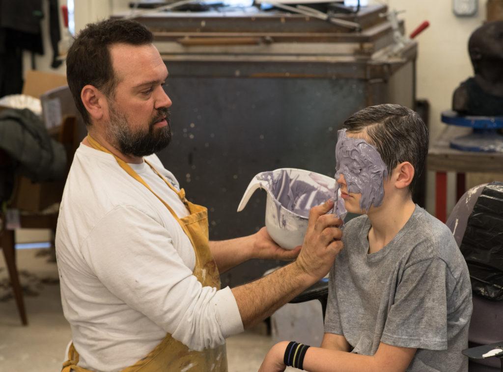 Penland resident artist Dean Allison making a mold of James Haley's head