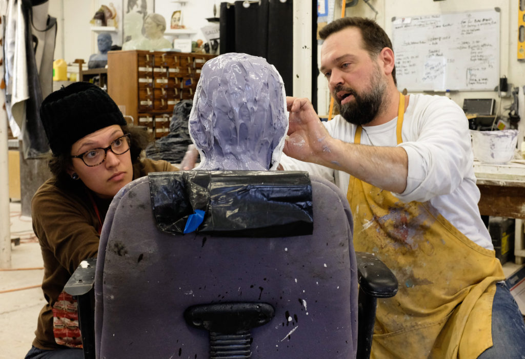 Penland resident artist Dean Allison making a mold of James Haley's head