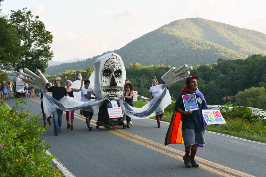 La Llorona float approaches with the mountain in the background