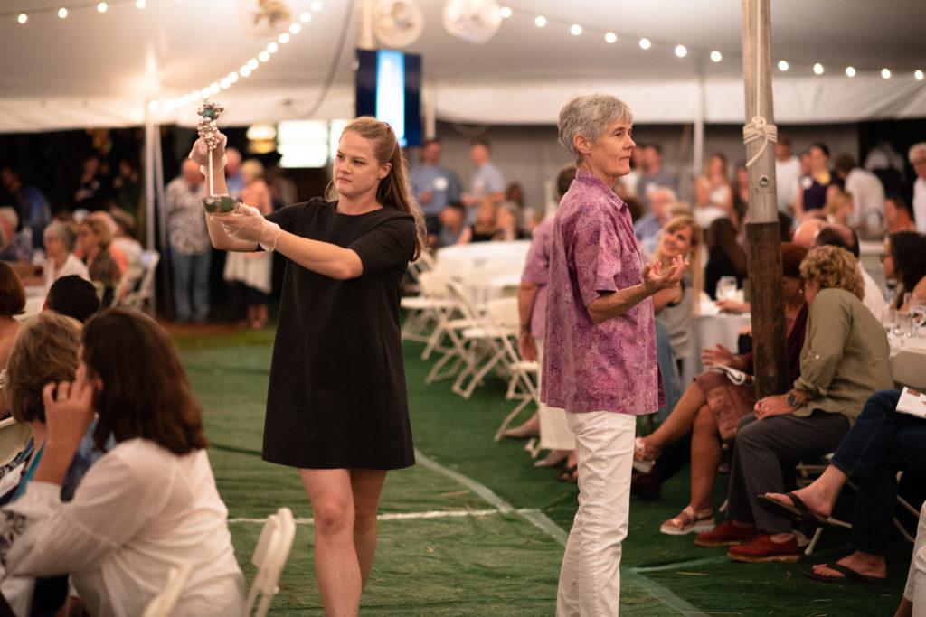 A volunteer shows off Julia Woodman's cocktail ladle.